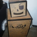 "Cardboard robot in the ""gallery"" part of the Rich Media Institute"