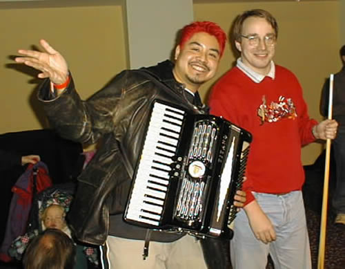 Joey deVilla and his accordion with Linus Torvalds