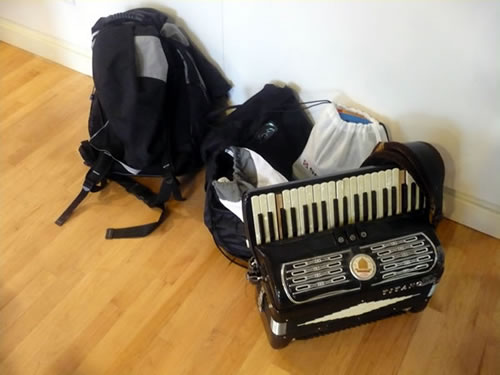A couple of knapsacks and an old accordion