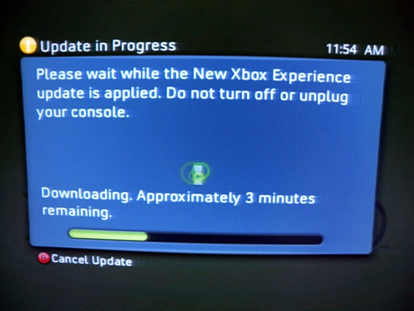 Photo of my TV showing the 'updating' dialog box for the New XBox Experience.