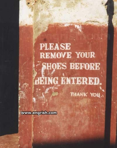 "Painted on the wall at a temple in India: ""Please remove your shoes before being entered."""