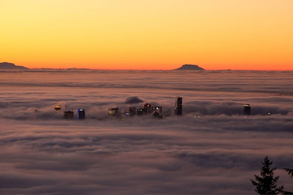 Photo of Vancouver skyline mostly obscured by fog