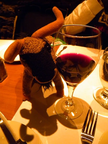 My plush gnu with a glass of red wine