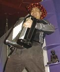 Joey deVilla and accordion, go-go dancing on a bar.