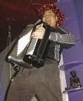 Joey deVilla and accordion, go-go dancing on a bar.