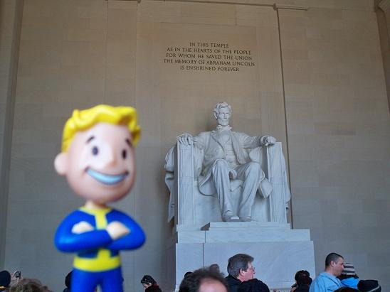 "The Lincoln Memorial, with the ""Vault Boy"" bobblehead in the foreground"