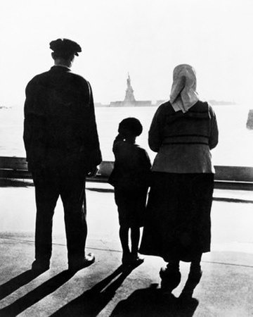 Immigrant family on Ellis Island looking at the Statue of Liberty in the distance