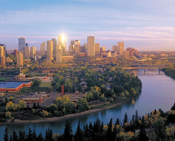 Edmonton skyline, with North Saskatchewan River in foreground.