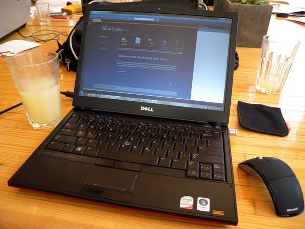 My laptop on the table at the Dark Horse Cafe