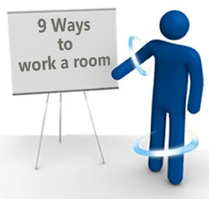 """TechDays """"blue man"""" pointing to an easel that reads """"9 Ways to work a room"""""""