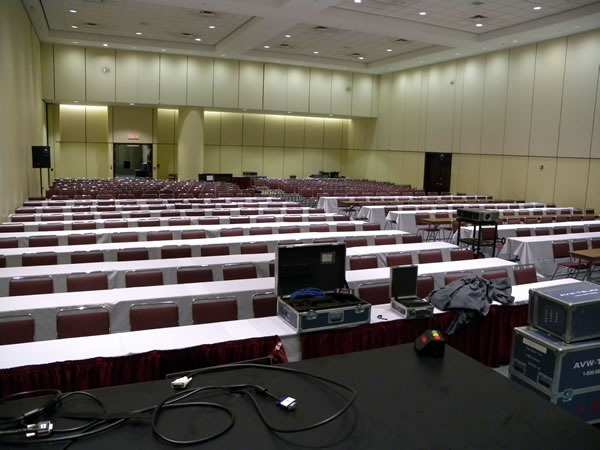 View of a large presentation room, as seen from the podium at the front.