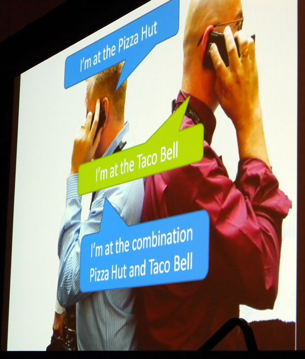 "Slide showing John Oxley and Damir Bersinic on cell phones, doing the ""Combination Pizza Hut and Taco Bell"" song"