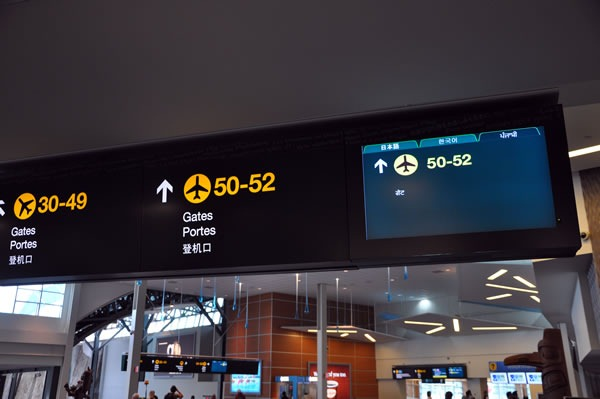 Gate signs at Vancouver airport, featuring a multilingual LCD sign using a tab control