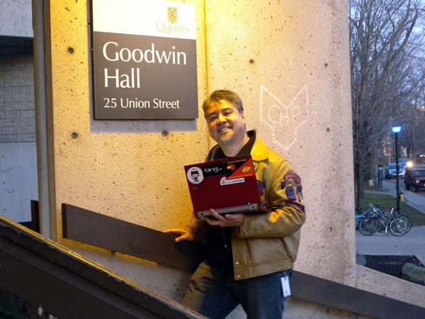 Me and my laptop, posing beside the sign at the entrance of Goodwin Hall