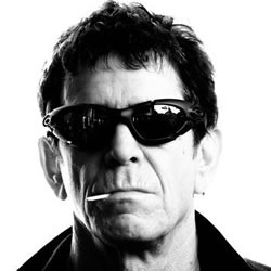 Lou Reed, in sunglasses, with a cigarette