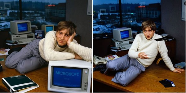 Bill Gates posing sexily on a desk with an old IBM PC running MS-DOS