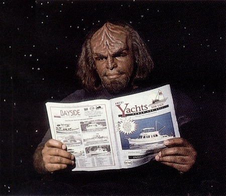 "Michale Dorn (""Worf"") reads ""Yachts for Sale"" magazine"