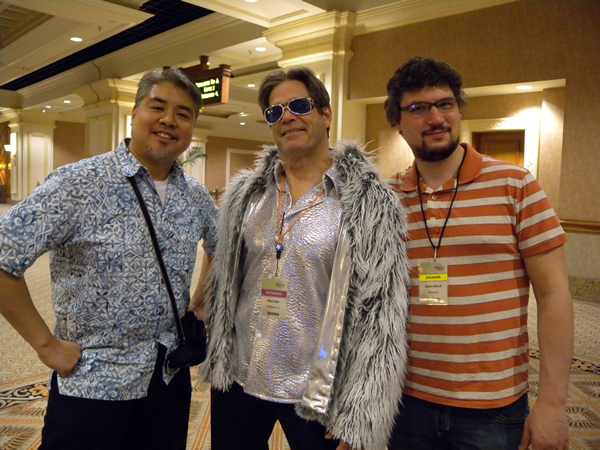 Joey deVilla in a Hawaiian shirt, Glenn block in silver lame shirt and fun fur jacket, and Glenn Block in a striped shirt
