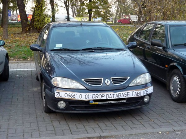 "Renault with a banner across its bumper reading ""ZU 0666', 0, 0); DROP DATABASE TABLE LICENCE;"""