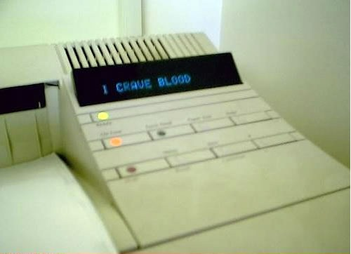 "Printer displaying the message ""I CRAVE BLOOD"""