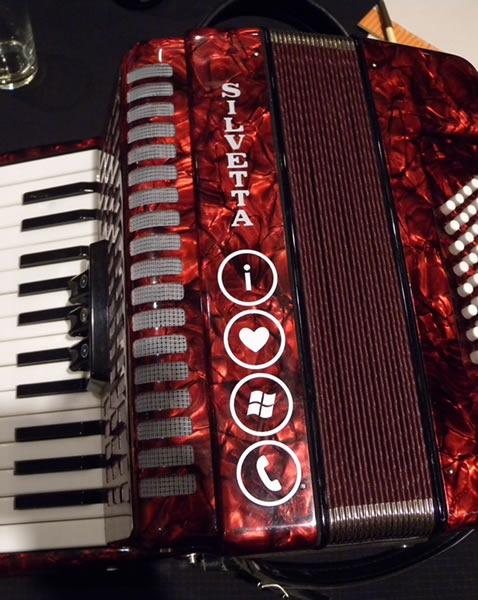 "Red Silvetta piano accordion with ""I Love Windows Phone"" sticker"