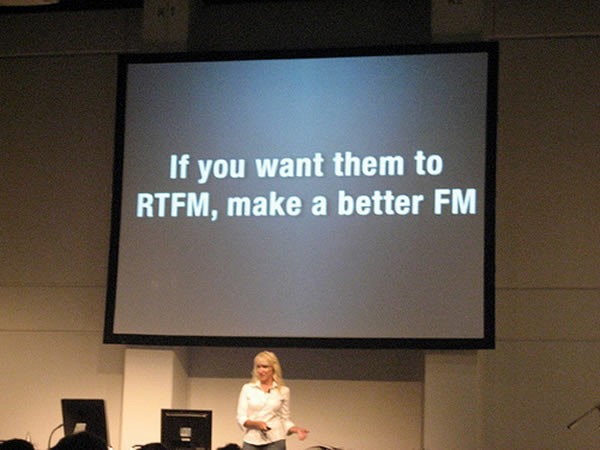 "Kathy Sierra showing a slide that reads ""If you want them to RTFM, make a better FM"""
