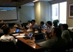 Photo of Windows Phone 7 bootcamp Montreal attendees sitting at a boardroom table