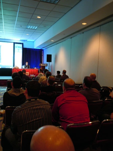 View of Mark Arteaga's presentation from the back of the room
