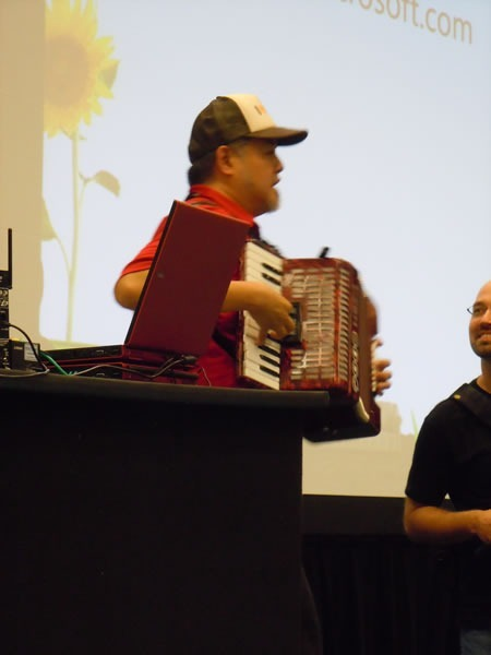 Joey deVilla plays accordion at Go DevMENTAL