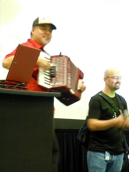 Joey deVilla plays his accordion at Go DevMENTAL as Andrew Gottlieb stands beside him