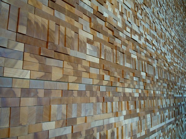 Detail of a wall inside the Vancouver Convention Centre's West Building, made up of the ends of planks of wood