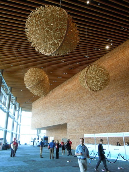 """TechDays registration area, with the giant """"eggs"""" made of hockey-stick-length pieces of wood hanging from the ceiling"""