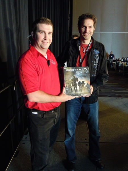 "Barnaby Jeans and Lowell Picklyk hold up the box for the limited edition ""Halo Reach"" Xbox 360"
