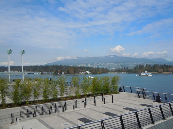 View of a promenade facing the water and mountains