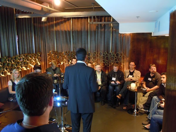 Arnaud Gabaudan makes a quick speech to the attendees in the lounge area of Glowball Grill as John Bristowe watches