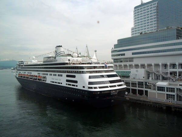 Holland America liner, moored to Vancouver Convention Centre's East Building