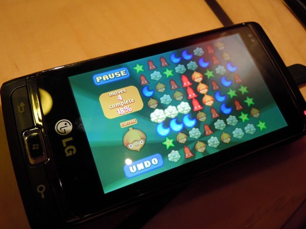 """My LG Windows Phone 7, with """"Smiles"""" displayed on the screen."""