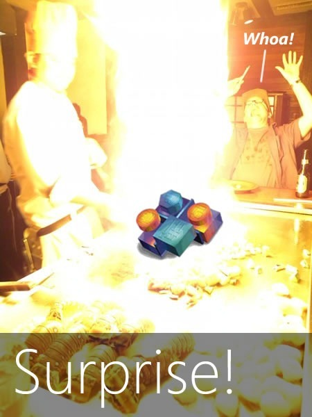 """Surprise!"" Rick Claus reels back in amazement from the flame-burst of a teppanyaki onion volcano"