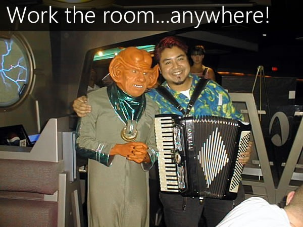 Joey deVilla, with accordion, schmoozing a Ferengi at Quark's
