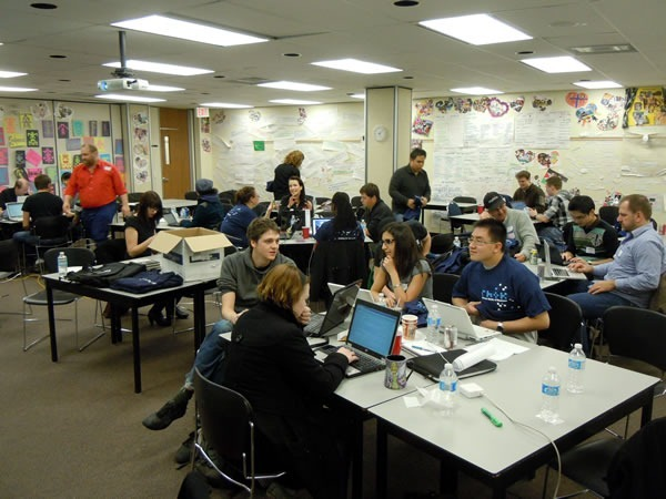 The main RHoK room as seen from the front, packed with developers working at various tables