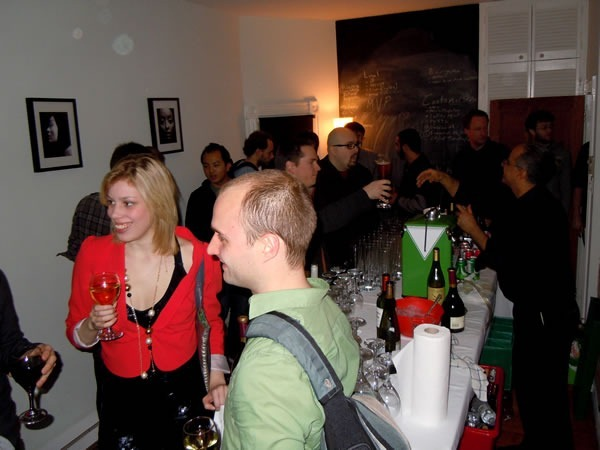 Unspace's boardroom, converted into a bar, filled with nerdy partygoers