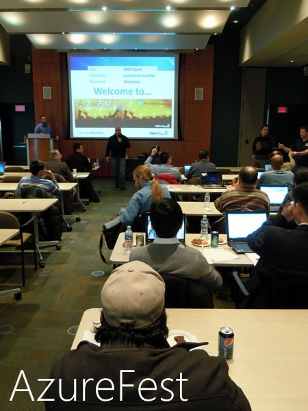 AzureFest attendees in Microsoft Canada's MPR room watch Cory Fowler and Barry Gervin at the front of the room.