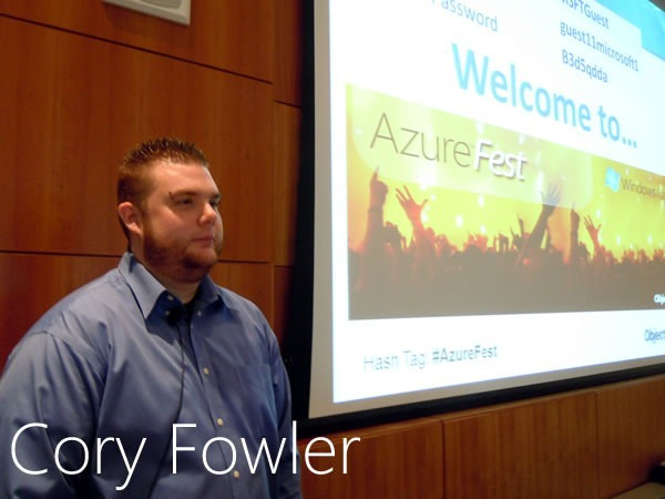 Cory Fowler stands beside the big screen in Microsoft Canada's MPR room
