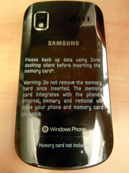 Back of Samsung Focus phone with sticker explaining memory card usage