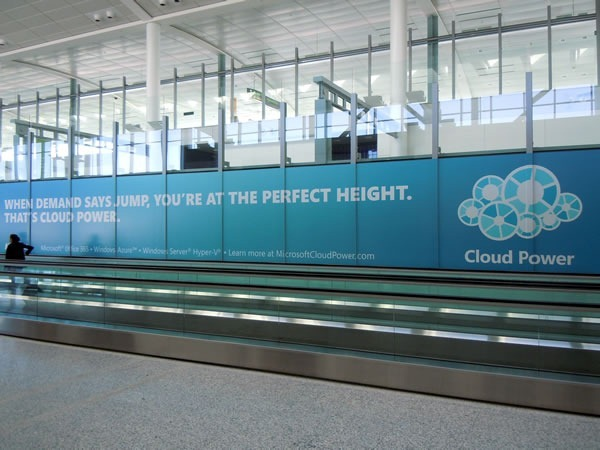 "Ad for Microsoft cloud solutions along walkway in Pearson Airport: ""When demand says jump, you're at the perfect height. That's cloud power."""