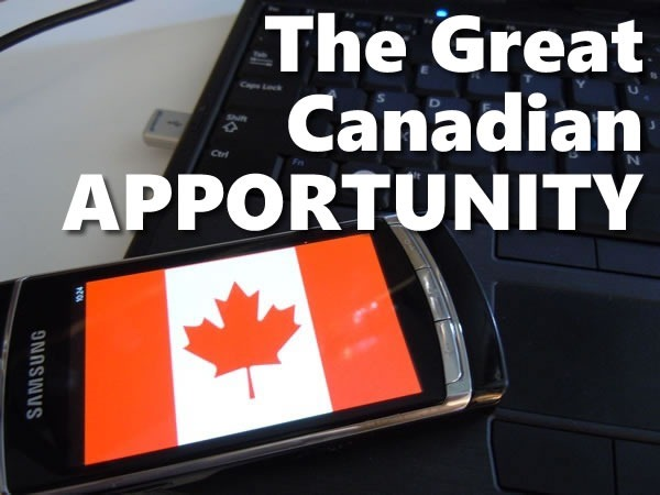 The Great Canadian Apportunity: photo of a Windows Phone displaying a Canadian flag, leaning against a windows laptop