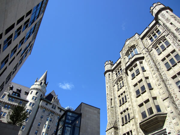The tops of Chateau Laurier and buildings on its east side