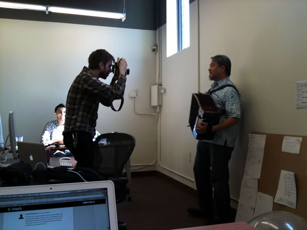 Ben Courtice taking photos of Joey deVilla as he plays accordion