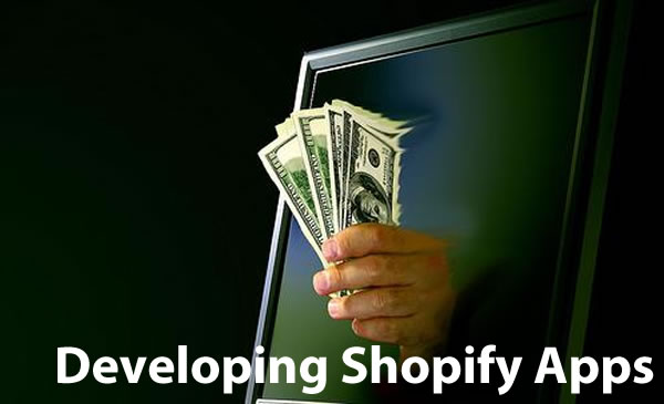 Developing Shopify Apps: Hand holding money emerging from a computer monitor