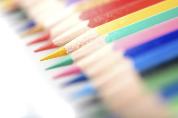 Colored pencils, all lined up in a row